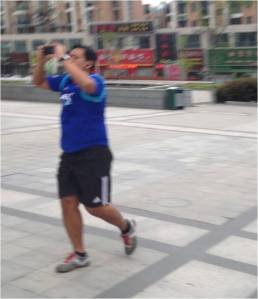 Running and Taking A Pic: He's A Tourist Just Like Me :)